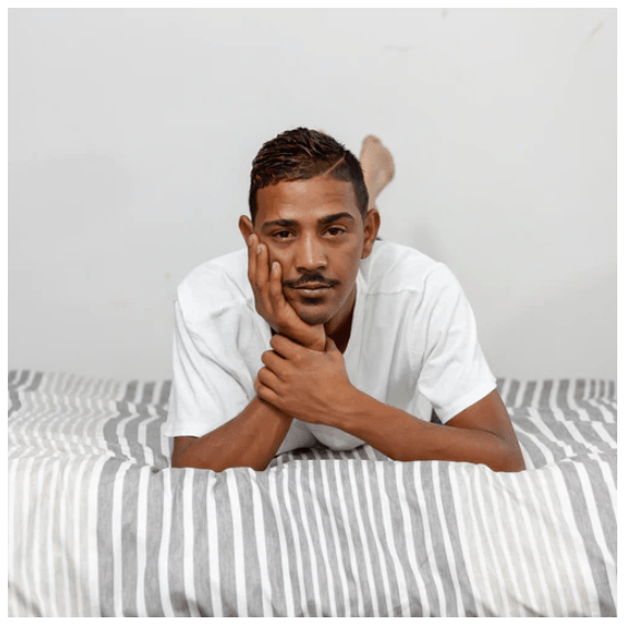 man smiling on the bed